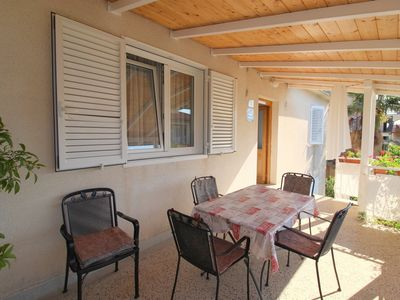 Photo for Holiday apartment only 30 m to the beach with air conditioning and balcony