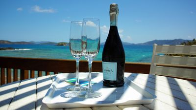 Enjoy your vacation with cold bubbly overlooking the vast of blue!