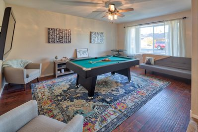 Game room with Pool table, TV, dart board and board games