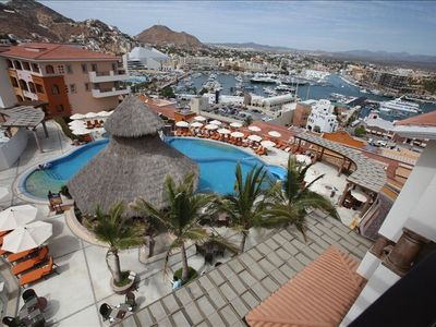 View from our balcony of the Eagles Nest, private pool, slide bar, Marina, Cabo