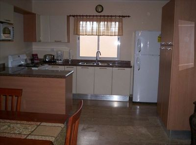 Kitchen has Granite Countertops, Gas Stove w/Oven, microwave, water cooler