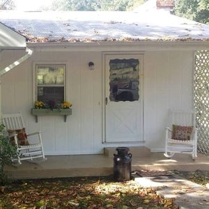 Country porch with Rain friendly tin roof!