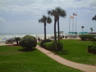 Nice grounds with grass , trees, 400 ft beach front with tables, grills, loungers