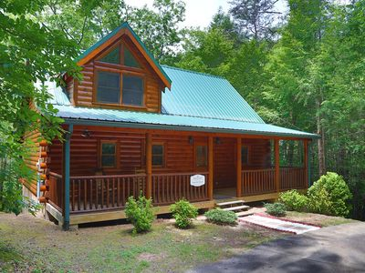 Photo for Pamper yourself in elegance at this dreamy cabin nestled on a treed acre for ultimate privacy!