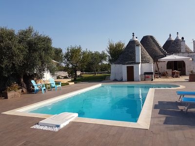 Photo for Beautiful Trulli with swimming pool in the countryside close to sand beach