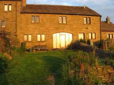 The rear of Midsummer Barn Holiday Cottage in a glorious sunset