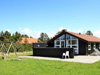 Photo for Cozy Holiday Home in Blavand with Swimming Pool
