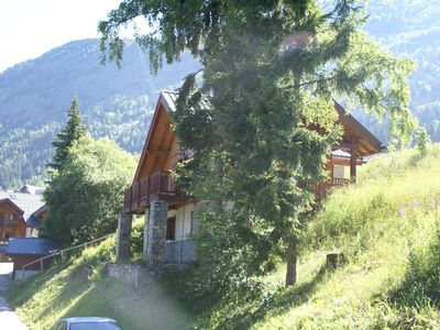 Photo for Mountain Chalet, hidden among the trees, with stunning views over lake