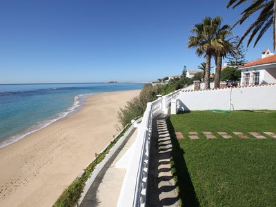 Photo for Los Canos De Meca: Wonderful Villa located in front line beach, over a small cliff. Private garden and terrace with magnificent sea views. There is a private access to the beach below.
