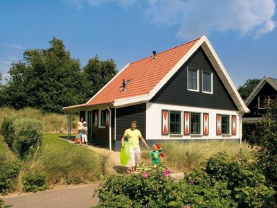 Photo for Bungalow in the holiday park Landal Duinpark 't Hof van Haamstede - Open-air swimming pool (May till August)