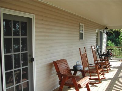 Relax on the covered porch after a busy day on the lake