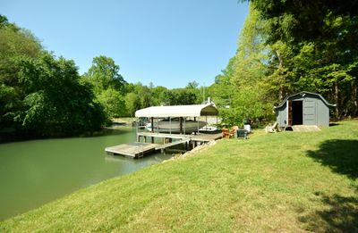 Floating dock to tie up boat and swim ladder