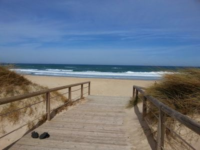 The boardwalk to the beach. Directly opposite the house.