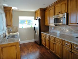 Kitchen equipped with refrigerator, microwave, electric cooktop