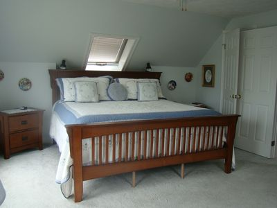 The master bedroom has a king size bed and a private deck with a beautiful view of the water.