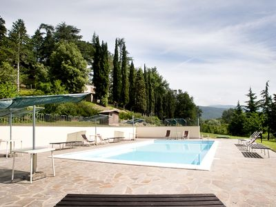 Photo for Cosy apartment in villa with internet, pool, TV, patio, pets allowed, panoramic view and parking