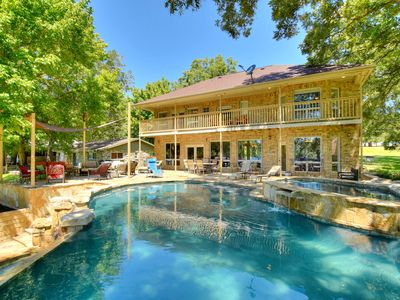 Back of the House with the pool and stone deck