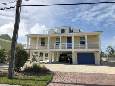 Photo for Beautiful Canal Front Single Family Home with Pool - Walk to the Beach