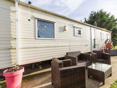 Photo for Retro theme 9 berth caravan for hire at Breydon water holiday ref 10031