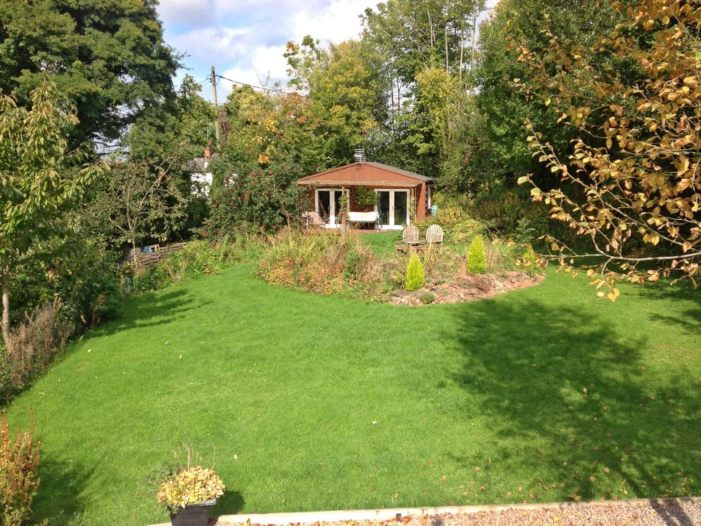 The basement is a self contained ground floor apartment for Garden design 2 acres