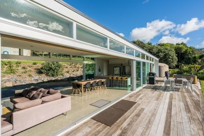 Fantastic indoor/outdoor flows onto decks that run the length of the house