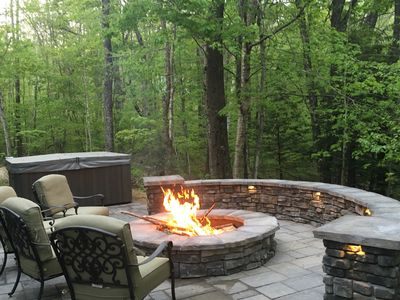 Hot tub and built in fire pit with seating wall for cozy nights with your group!