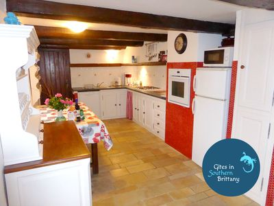 The large fully equipped Breton farmstyle kitchen