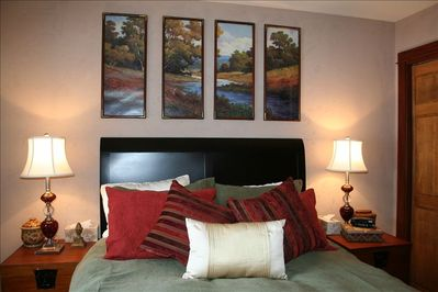 Queen bed, feather quilt and pillows