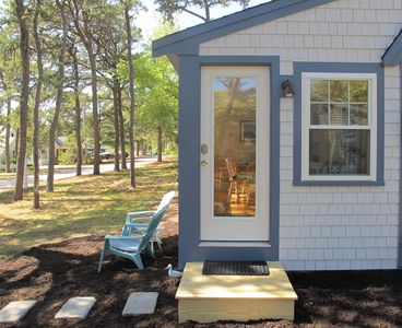 Front door of Summer Pines Cottage in private, lakefront community setting.