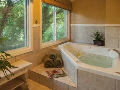 Jetted tub in separate room overlooking our lake