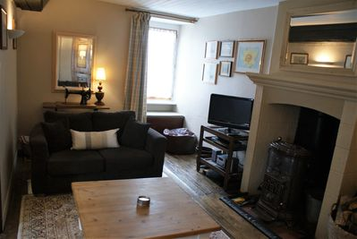 Living room with woodburner and TV etc