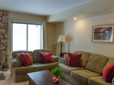 Photo for Cozy corner condo with shared pool and hot tub, close to the lakes & ski resort!