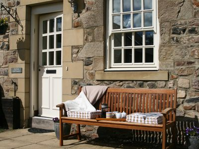Photo for Spacious stone built coastal cottage, sleeps 6 with private garden and parking