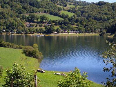 Photo for Canvas Bungalow at the edge of the water at Camping La Romiguière ***