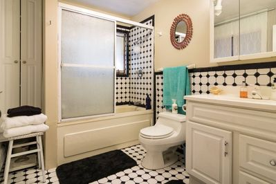 Ceramic tiled Master bath features both Jacuzzi tub and shower