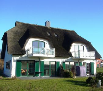 Photo for Exclusive apartment Peter Pan in a thatched cottage with sea views, sauna and wireless internet