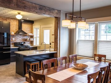 Open Kitchen Dining Room. Table seats 8.