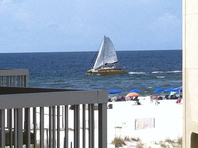 I captured this picture from my balcony of a sailboat passing by!