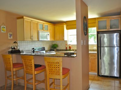 Fully equipped Kitchen with granite counter tops and extra seating