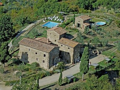 Photo for Nice apartment with WIFI, pool, pets allowed, panoramic view and parking, close to Greve In Chia...