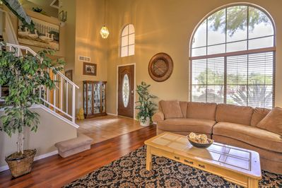 Tiled flooring, tall ceilings & a sitting room with plush furniture greets you.