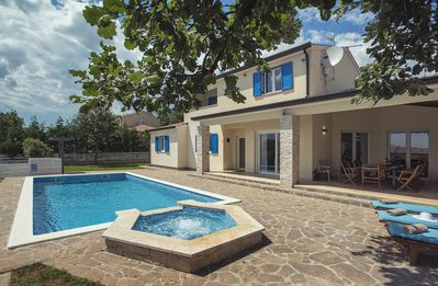 Photo for Unique villa with large private pool, 5 bedrooms, 4 bathrooms, air conditioning, wireless internet, table tennis, fitness equipment, BBQ and an outdoor sauna