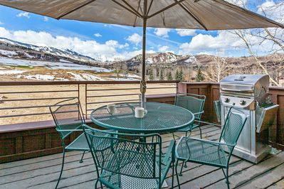 Balcony - A private deck with seating for 4 and a gas grill; enjoy stunning views towards Mount Daly.