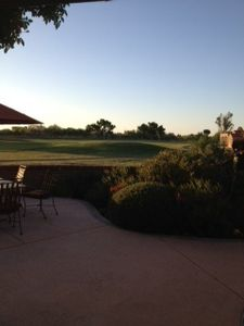 view from the patio as the sun sets on the 7th fairway