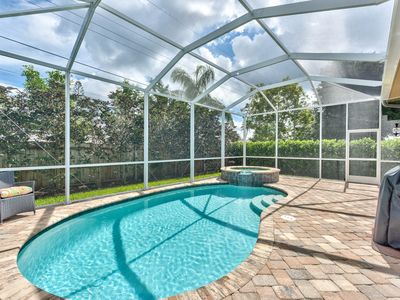 Photo for Breathtaking Pool Home w/ Hot Tub; minutes to  Vanderbilt Beach; All New Decor!