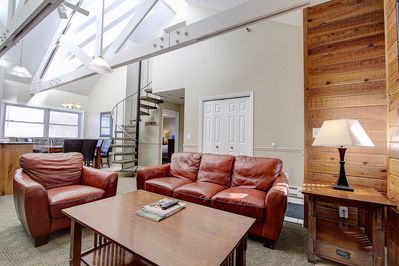 Living room, high ceiling, sky light, w circular stairs to upper BR & bath