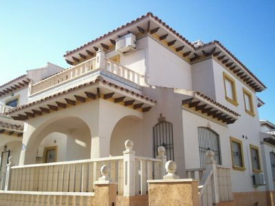 Photo for 12r9 2 bedroom villa sleeps 7 set in quiet family location 5 minutes to shops
