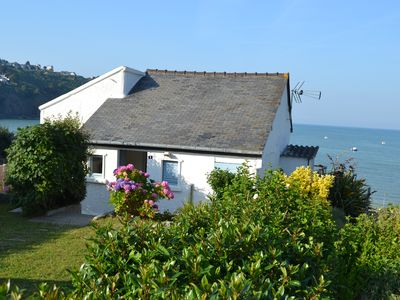 Photo for Small house facing the sea, exceptional view on the bay, as on a boat
