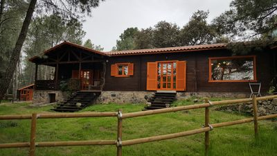 Photo for Wooden house in the woods, on a farm with horses. Very close to Madrid. Beef