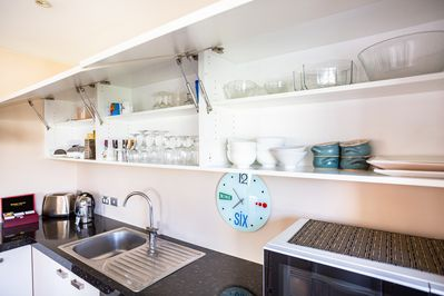 The kitchen comes fully-equipped with cooking utensils for you to use.